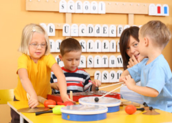 Preschool boys and girls playing