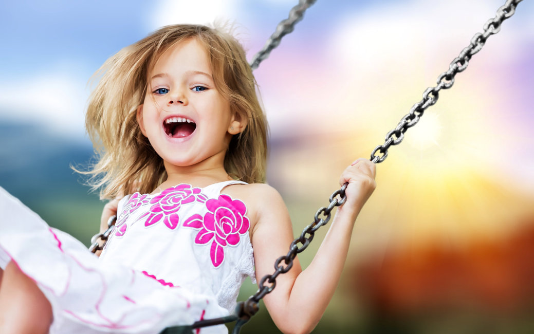 Little child blond girl having fun